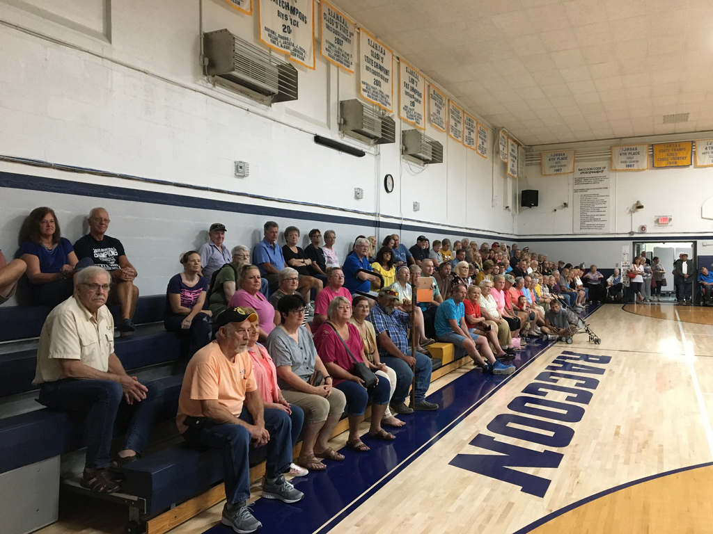 Grandparents fill the gym.